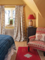 Malika Blue Curtains and Ikat Chair
