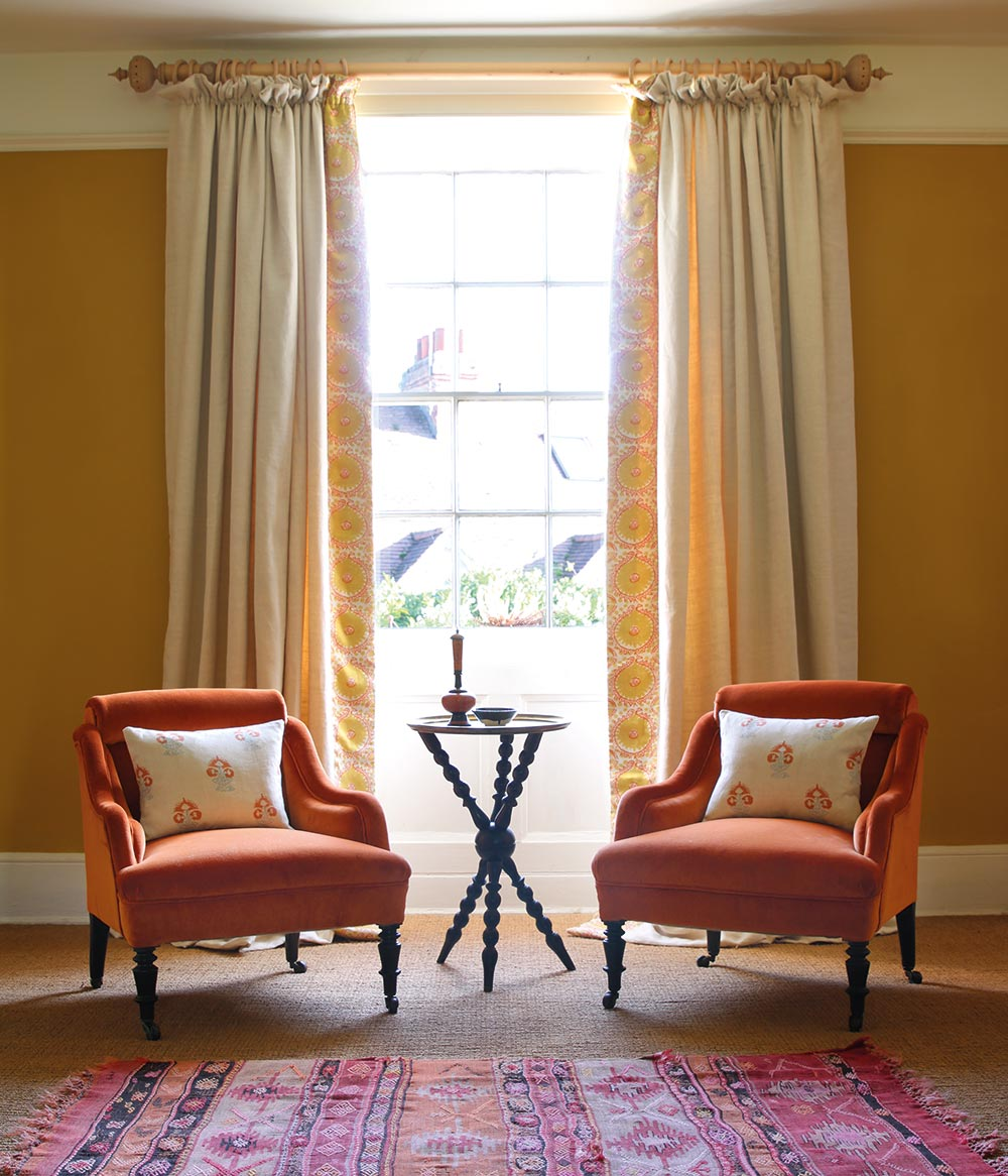 Light Plain & Hirmani Saffron Curtains and Orange Velvet Chairs